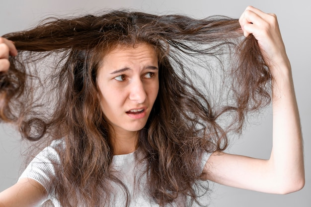 Woman worried about tangled hair
