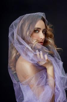 Woman wrapped in purple fabric, beautiful figure