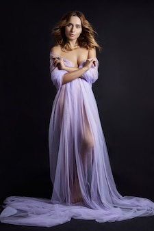 Woman wrapped in purple fabric, beautiful figure