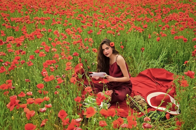 Woman writer in poppy flower field. remembrance or anzac day. journalism and writing.