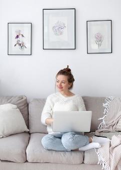 Woman writing a blog at home