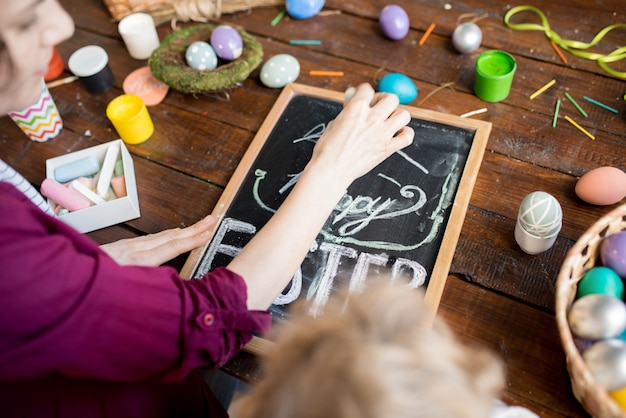 Woman writing happy easter