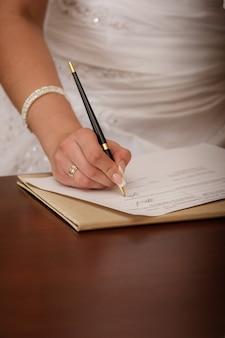 Woman writing on her agenda