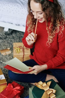 Woman writing letter for santa claus