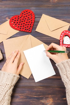 Woman writing love letter or romantic poem for valentines day