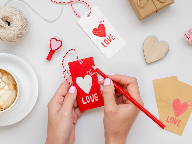 Woman writing on love tag