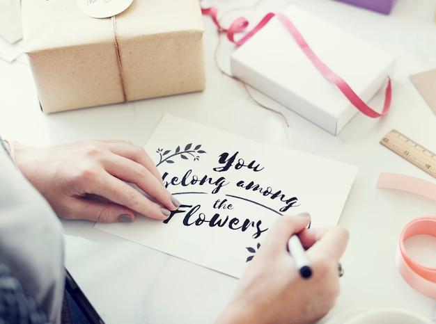 Woman writing a wishing card