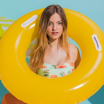 Woman in yellow lifesaver on beach