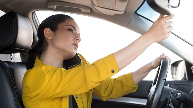 Woman in yellow shirt doing multiple tasks