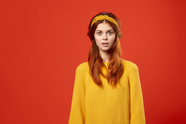 Woman in a yellow sweater with a bandage on her head hipster accessories studio