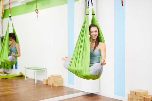 Woman in yoga hammock