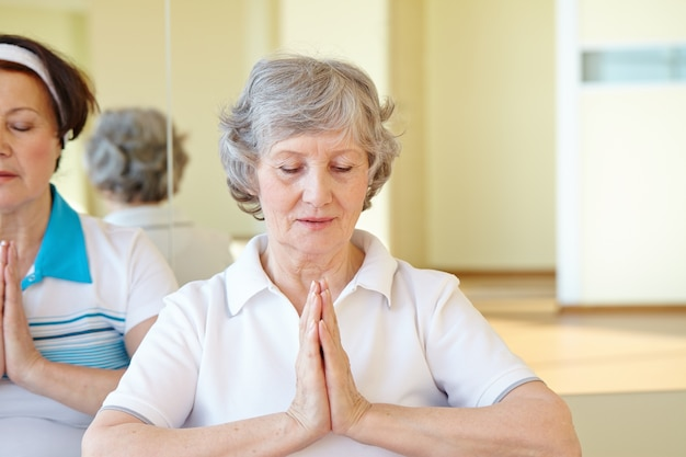 Woman in yoga pose sitting on the floor