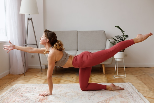 Woman in yoga position good morning at home