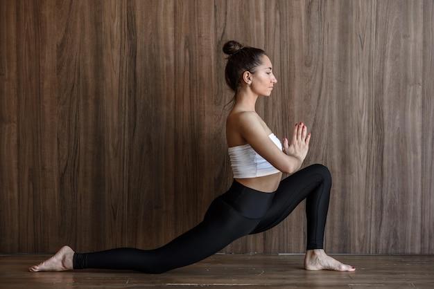Woman yogi meditate practicing yoga and stretching