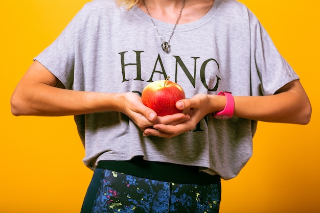 Woman at yours casual outfit holding apple