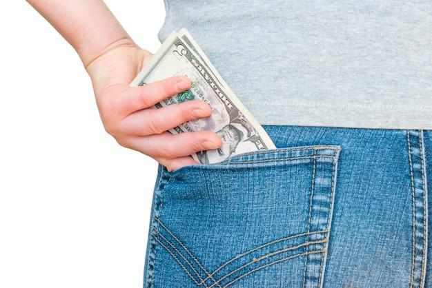 Womanã ¢ â € ™ 손 흰색 배경에 고립 된 청바지 주머니에 달러 돈을 넣고