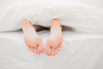 Womans feet sticking out of blanket