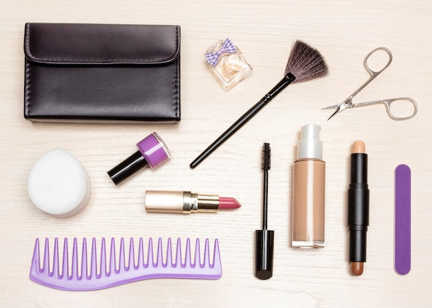 Women accessories on light wooden table, flat lay. beauty essentials