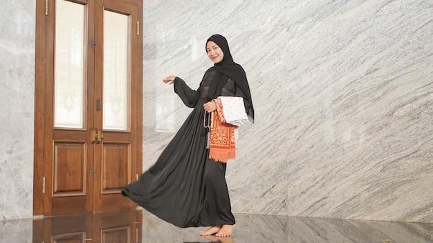 Women after worship look beautiful wearing black muslim clothes