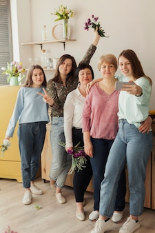 Women of all ages holding flowers