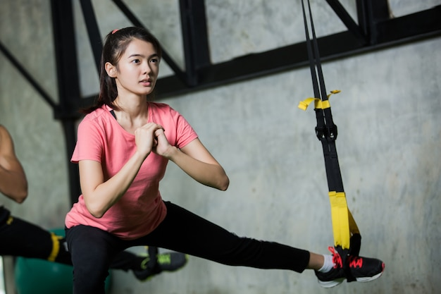 Women are exercising in the gym. she has committed.