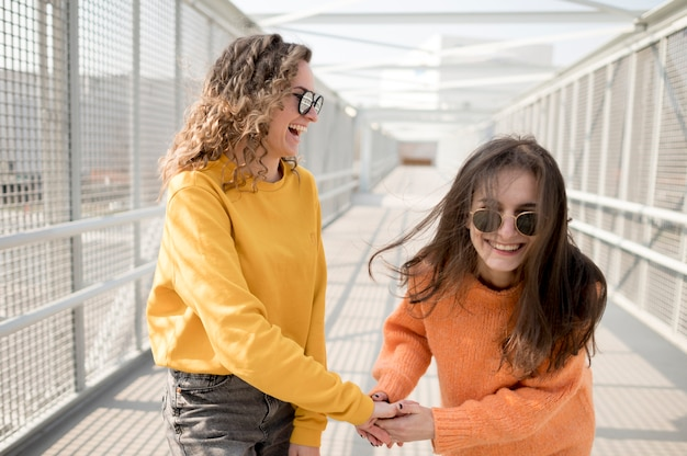 Women on a bridge fooling around