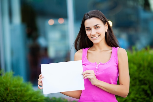Women business with the poster with welcome message