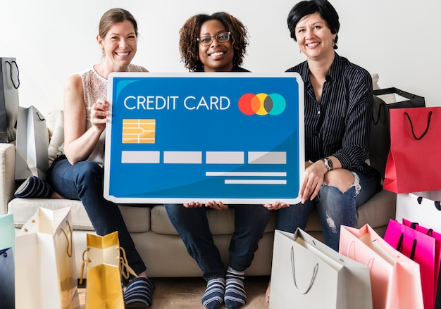Women carrying credit card icon