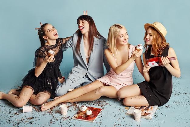Women celebrate holiday party having fun eat cakes