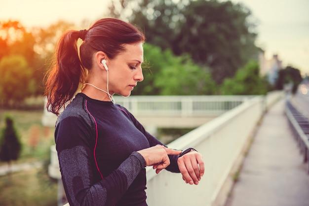 Women checking fitness tracker