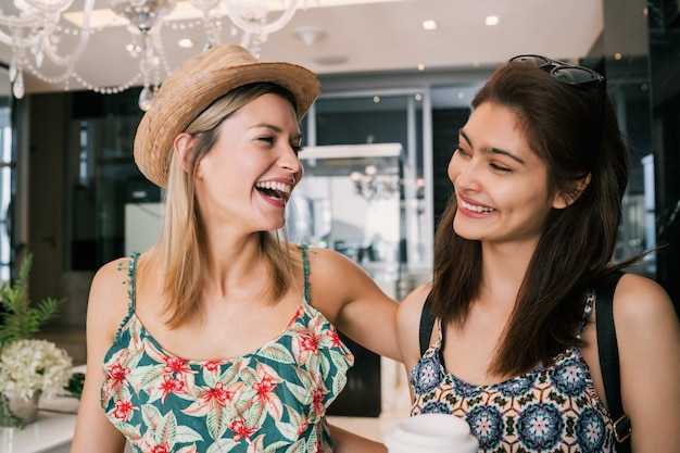Women in colorful clothes laughing together