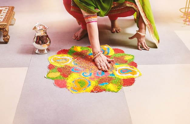 Women coloring traditional rice art
