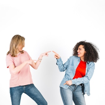 Women dancing and pointing at each other