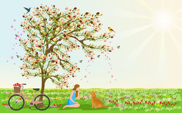 Women and dogs sit under the flower tree
