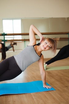 Women doing sport in gym, healthcare lifestyle people concept, modern loft studio.