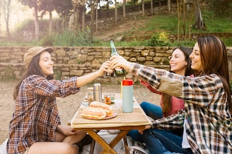 Women drinking beer in nature
