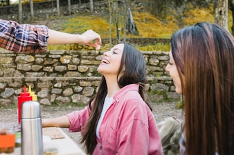 Women eating and having fun in nature
