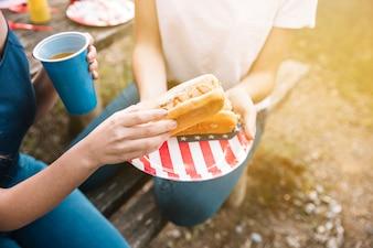 Women eating hot-dogs