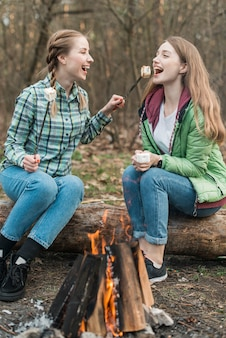 Women eating marshmallow