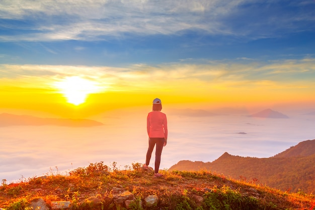 Women enjoy the fresh air and embrace the nature in the morning at phu chi dao ,thailand