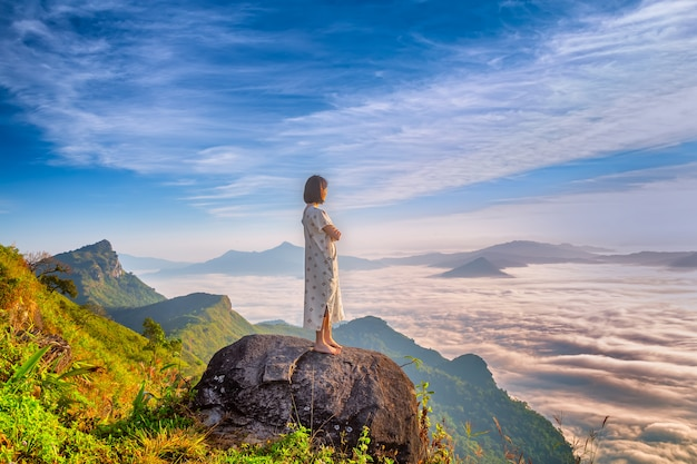 Women enjoy the fresh air and embrace the naturein the morning at phu chi dao ,thailand