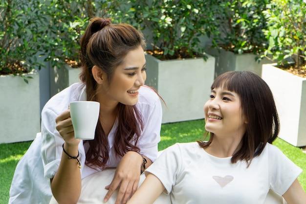 Women enjoy leisure time on garden