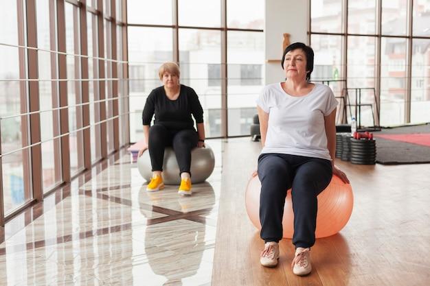 Women exercising on balls