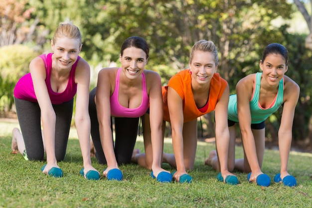 Women exercising with dumbbells