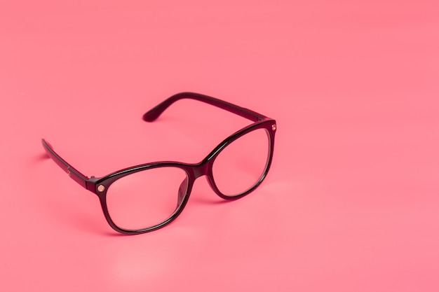 Women fashion glasses close up on bright colored