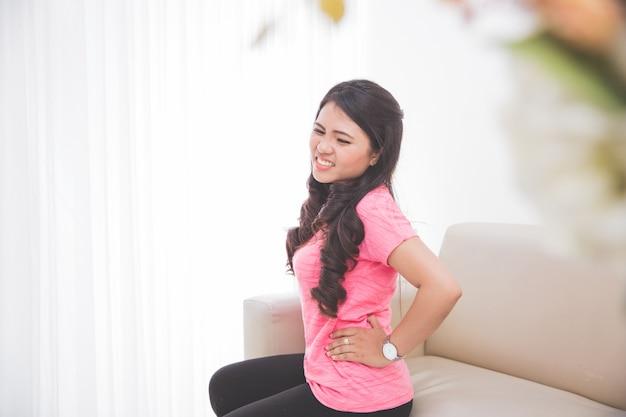 Women feeling unwell on her stomach