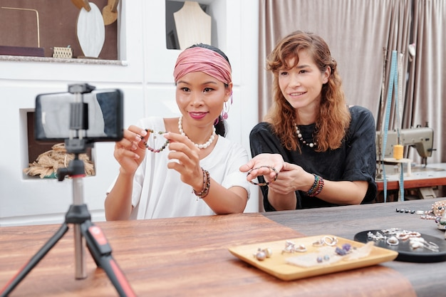 Women filming collection of jewelry