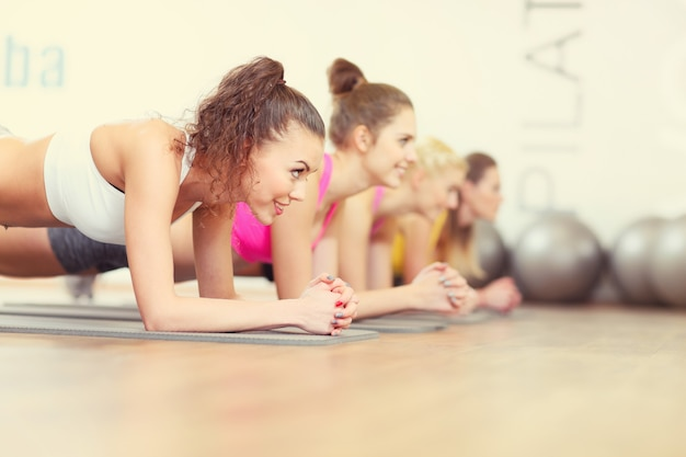 Women group working out in gym