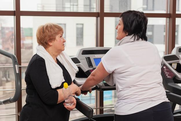 Women at gym talking