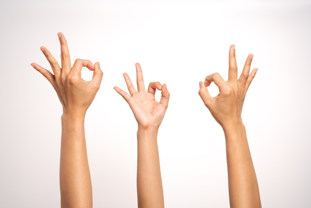 Women hand ok sign gesturing on white background in three action